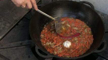 Chili and garlic in Pilaf in Wok, Closeup