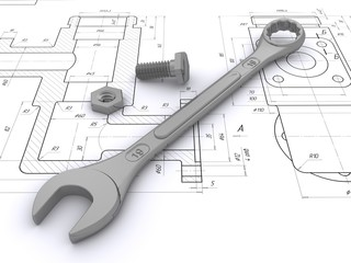 wrench, bolt and nut against engineering drawings