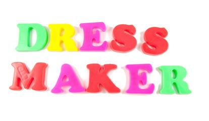 dress maker written in fridge magnets on white background