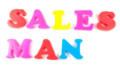 sales man written in fridge magnets on white background