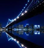New York City Skyline and Manhattan Bridge At Night - 28624440