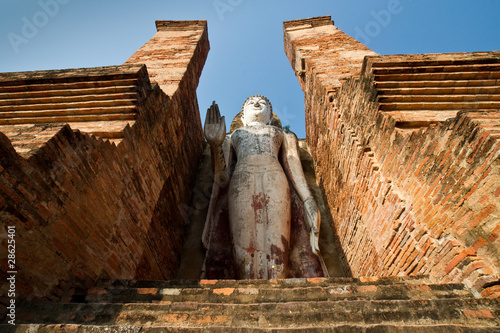 buddha staue in the temple ruins of sukhothai in thailand . .