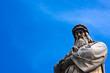 Da Vinci statue with blue sky