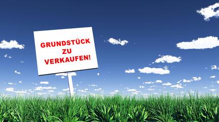 Schild im Gras - Grundstück zu verkaufen