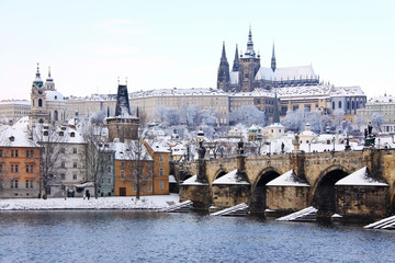 First Snow in Prague, gothic Castle with the Charles Bridge