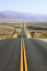 Abrupt bends of road on  the Californian steppes