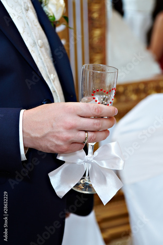 Wedding glass of champagne in hand groom