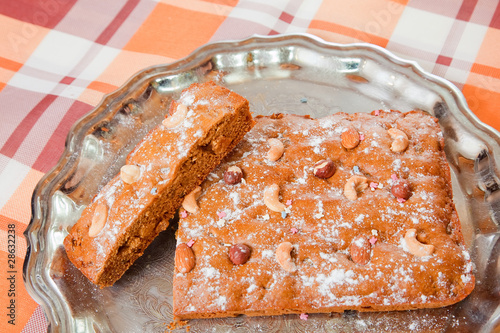honey cake with nuts on tray
