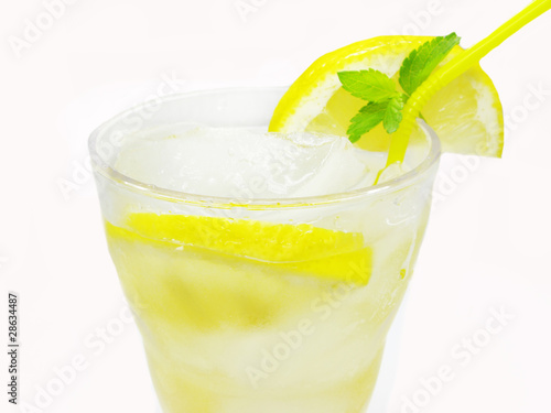 yellow lemonade with ice and lemon