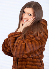 beautiful young woman in a fur coat