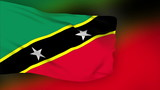 St Christopher Nevis flag slowly waving. Blurred background.