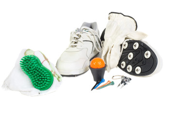 Golf shoes, glove and accessories on a white back ground