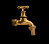Metallic faucet isolated on black background