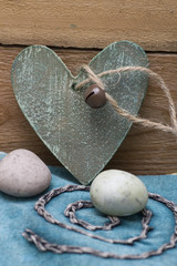 Wooden heart and sweet eggs in pastel