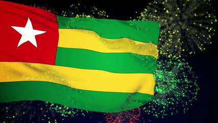 Togo flag waving. Fireworks background. Seamless loop.