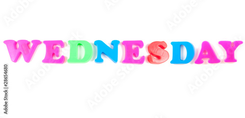 wednesday written in fridge magnets on white background