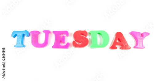 tuesday written in fridge magnets on white background