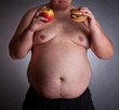 Fat man with burger and apple
