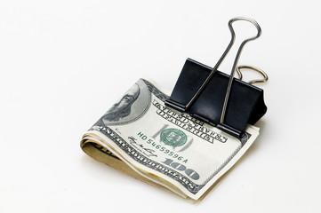 Dólares  en fondo blanco con sujeta PAPEL