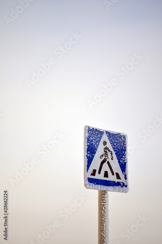 Road sign, crosswalk, snowman