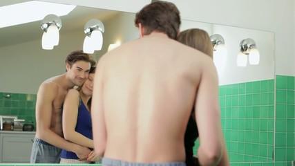 young heterosexual couple in bathroom
