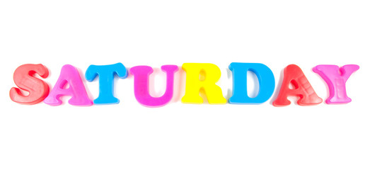 saturday written with fridge magnets on white background