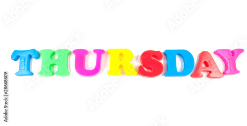 thursday written with fridge magnets on white background