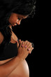 Young African American Woman Pregnant Praying