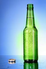 Bottle of beer on blue background