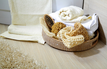 Towels and sponge in a basket
