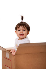 Happy baby in moving box