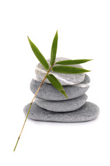 Stacked of zen stone with bamboo leaf