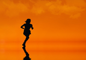 Silhouette of a  female  Jogger