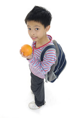 smiling boy with orange and book ready to go to school