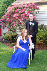 Prom Girl Sitting Beside Date Outdoors