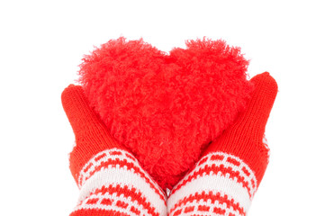 woman hands in red mittens tenderly keeping red heart
