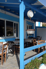 Greek taverna and old scales - Typical restaurant of Dodecanese