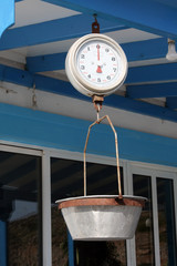 Old scales in greek taverna, used to weight the fish - Greece