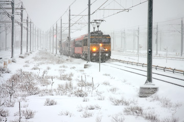 Train driving in snowstorm  in Amsterdam the Netherlands