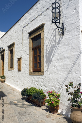 White house in Patmos and streetlamp - Dodecanese
