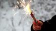 Firework fire in children's hand in snow forest