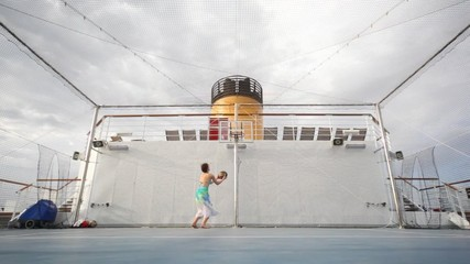 woman plays basketball on open-air playground