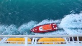 cutter sailing to cruise ship in sea