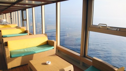couchs and tables on indoor deck of ship