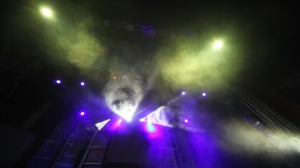 stage of nightclub with dynamic disco searchlights