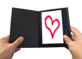 eBook reader with a heart on the screen poster