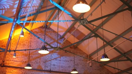 Colour projectors lighting the concrete roof and bars on disco