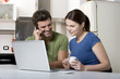 couple in the kitchen with laptop