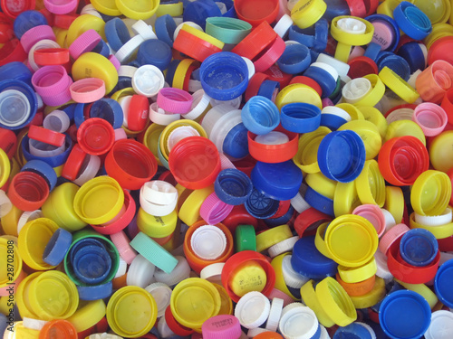 colored plastic caps ready to be recycled - 28702808