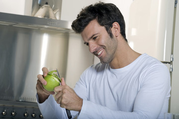 man peeling an apple
